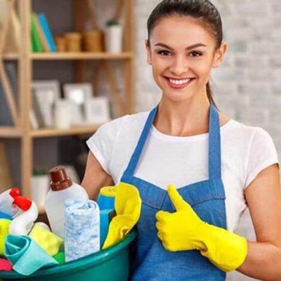 Lady holding all the equipment of a cleaning company